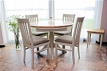 3231/Stag-Cromwell-Round-Extending-Dining-Table